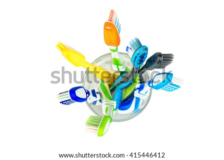 Many toothbrushes in a glass on a white background, top view - stock photo