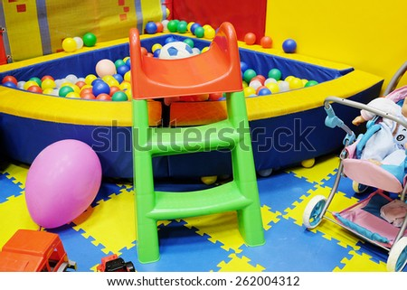 Many toys in the children's playroom - stock photo