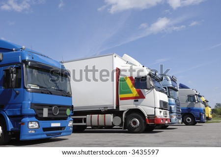 many trucks on line-up waiting for cargo loading, no trademarks - stock photo