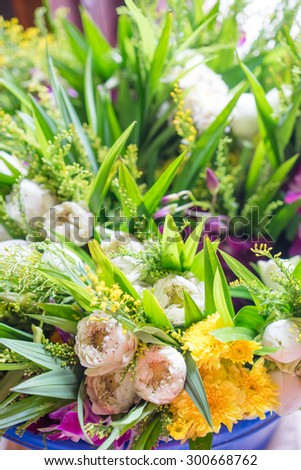 Many types of flowers and white lotus for buddha - stock photo