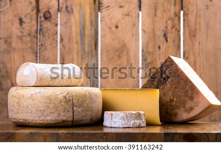 many types of french cheese - rondin de brebis, ossau-iraty, camembert, comte, vieux
