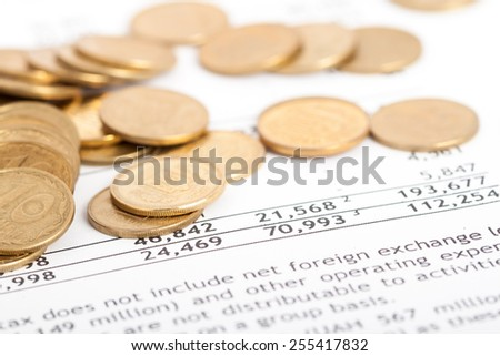 many ukrainian coins laid out on document with numbers