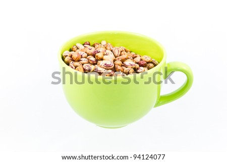 Many uncooked beans in cup