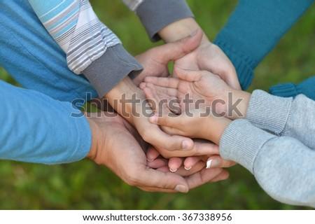 many United hands - stock photo