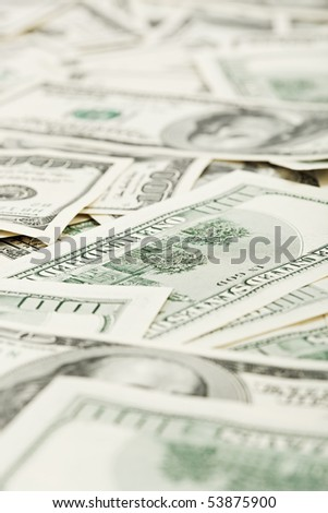 Many US 100 dollars, business background, shallow depth of field - stock photo