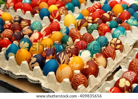 many various colorful easter eggs in eggboxes, Serbia - stock photo