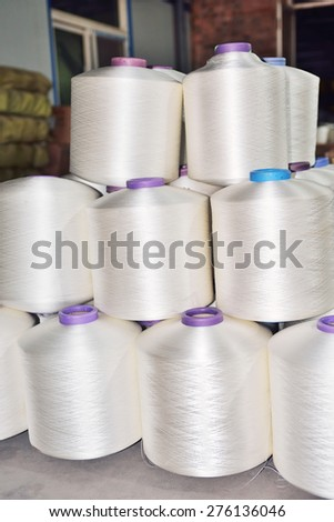 Many weave yarn axis piled up in factories