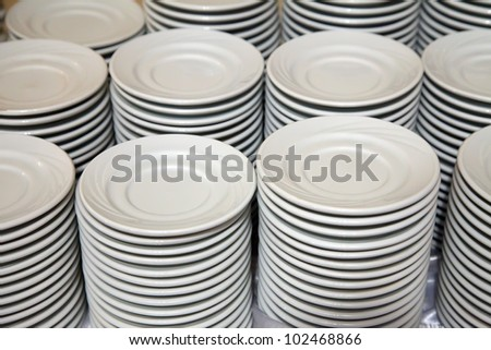 Many  white different plates stacked together - stock photo