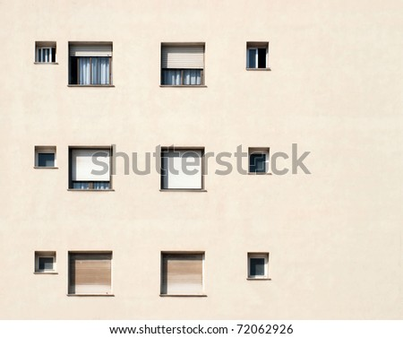 Many windows on residential building / Windows / Barcelona, Spain - stock photo