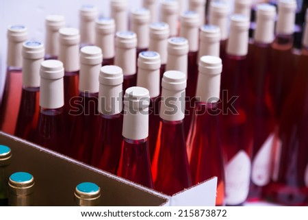 Many wine bottles at  store or winery factory  - stock photo