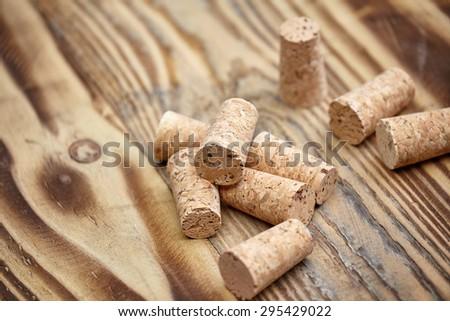 Many wine corks on wood barrel - stock photo