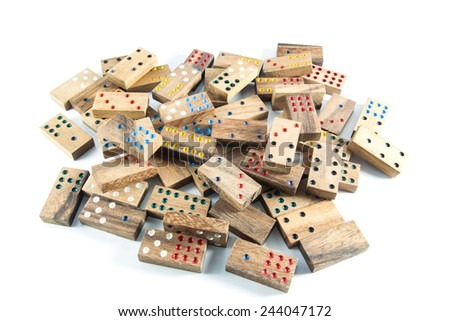 many wood dominoes on isolated , white background - stock photo