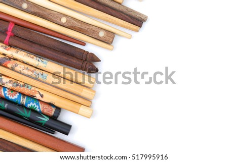 Many wooden chopsticks isolated on white background. Decorative wooden chopsticks background. Many chopsticks corner. Chopsticks distributed on white background. Chopsticks heap. Lot of chopsticks.
