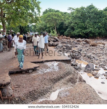 MANYARA, TANZANIA - NOVEMBER 28: The catastrophic debris flow destroyed a road between national parks Manyara and Ngorongoro. Car traffic was restored on the same day, on November 28, 2011 in Manyara, Tanzania - stock photo