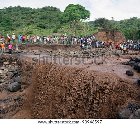 MANYARA, TANZANIA - NOVEMBER 28: The catastrophic mudflow flow destroyed a road between national parks Manyara and Ngorongoro. Car traffic was restored on  same day, on November 28, 2011 in Tanzania - stock photo