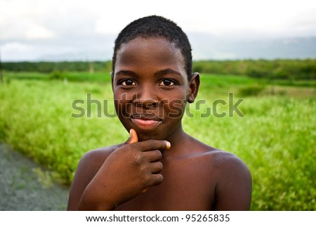 MANZINI, SWAZILAND-DEC 27: Portrait of unidentified Swazi boy on Dec 27, 2007 in a small village near Manzini, Swaziland.  Close to 10% of Swaziland's total population are orphans, due to HIV/AIDS. - stock photo