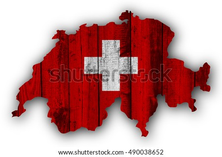 Map and flag of Switzerland on weathered wood