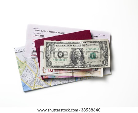 Map, flight ticket, passport and money on a white surface. - stock photo