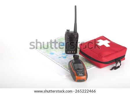 Map, gps navigator, portable radio and first aid kit on a light background. Set lifeguard. - stock photo