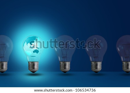 map inside glow among other light bulb on a blue background - stock photo