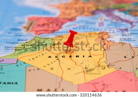 Map of algeria with a red pin - stock photo