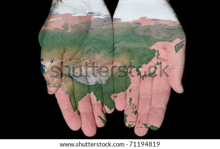 Map Of Asia Painted On Hands Showing Concept Of Asia In Our Hands - stock photo