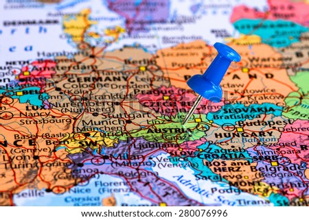 Map of Austria with a blue pushpin stuck - stock photo