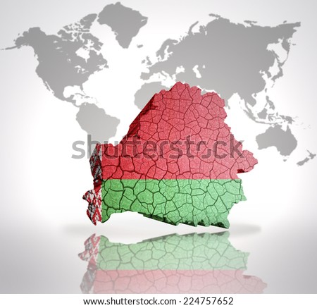 Map of Belarus with Belorussian Flag on a world map background - stock photo