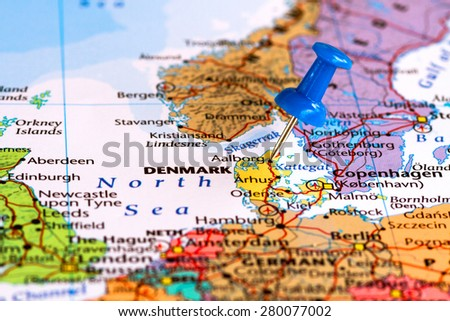 Map of Denmark with a blue pushpin stuck - stock photo