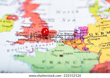 Map of Europe with a round red push pin placed on the city of London - stock photo