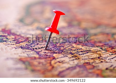 Map of France with a red pushpin stuck - stock photo