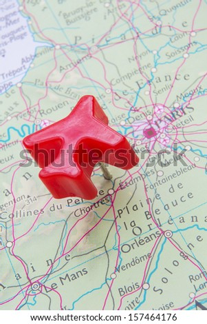 Map Of France With Model Plane Over Paris - stock photo