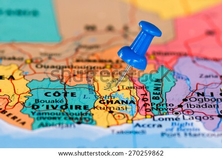 Map of Ghana with a blue pushpin stuck - stock photo
