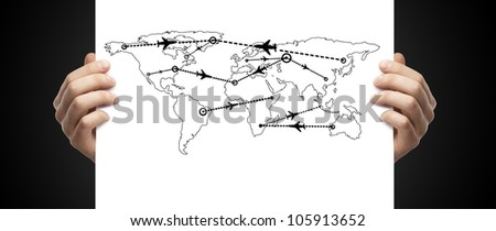 map of international flights in hand on a black background - stock photo