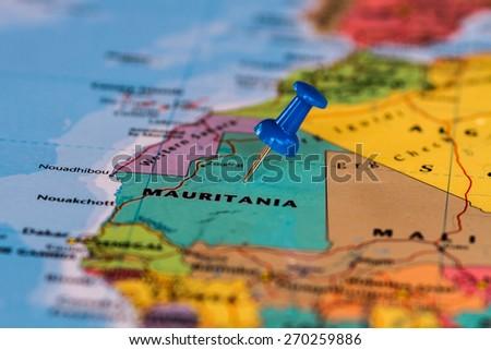 Map of Mauritania with a blue pushpin stuck - stock photo