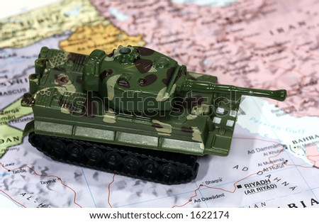 Map of Middle East and Toy Tank - Fight Terrorism Concept - stock photo