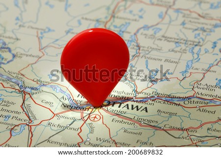 Map of Ottawa/Red map pointer stuck into of Ottawa - stock photo