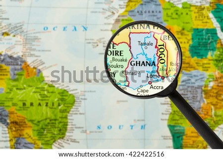 Map of Republic of Ghana through magnigying glass - stock photo