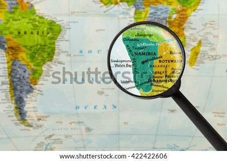 Map of Republic of Namibia through magnigying glass - stock photo