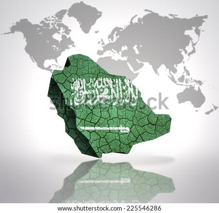Map of Saudi Arabia with Saudi Arabia Flag on a world map background - stock photo