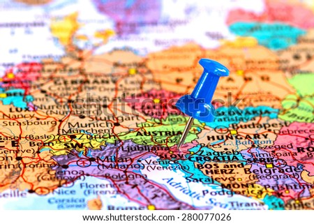 Map of Slovenia with a blue pushpin stuck - stock photo