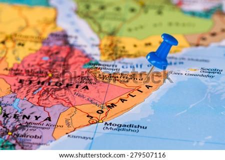Map of Somalia with a blue pushpin stuck - stock photo