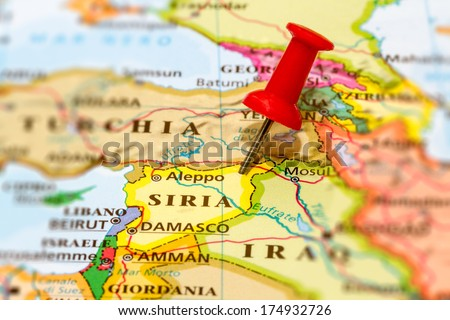 Map of Syria with a white pushpin stuck - stock photo