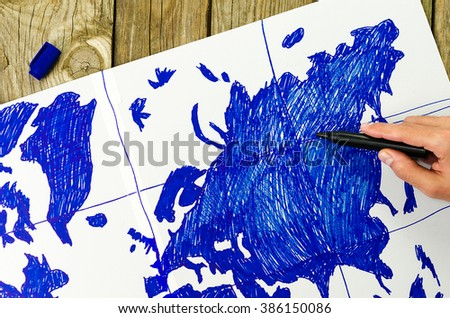 Map of the world drawn by hand on paper - stock photo