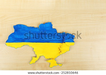 Map of Ukraine - concept of disintegration of the country - stock photo