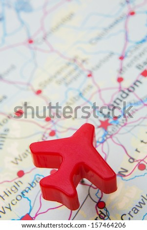 Map Of United Kingdom With Model Plane Over London - stock photo