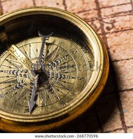 Map. Old compass on vintage map. Adventure stories background - stock photo