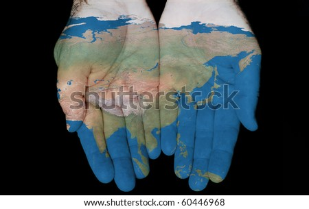 Map painted on hands showing concept of having Asia in our hands - stock photo