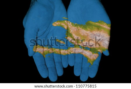 Map painted on hands showing concept of having Haiti in our hands