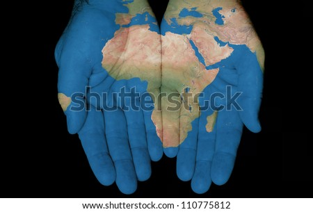 Map painted on hands showing concept of having the Country Of Africa in our hands - stock photo